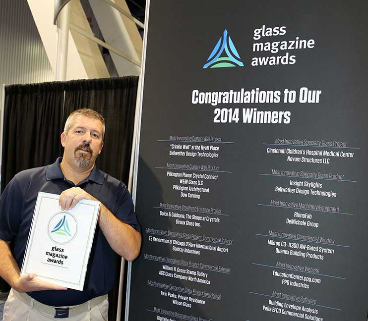 Bellwether's Mike Maguire accepts Glass Magazine Award