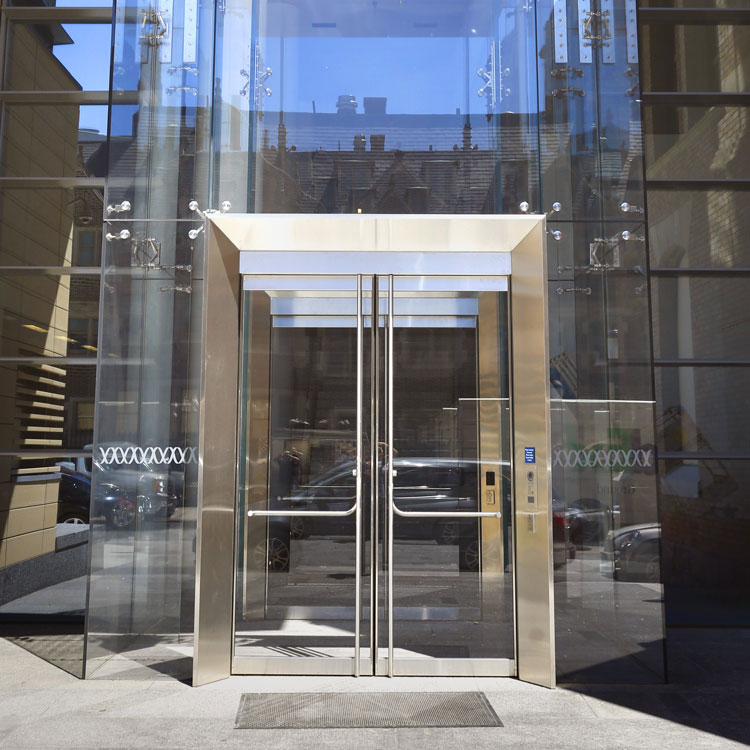 Glass vestibule with framed structural portal Wistar & Glass vestibule door openings and framed door portal design ...