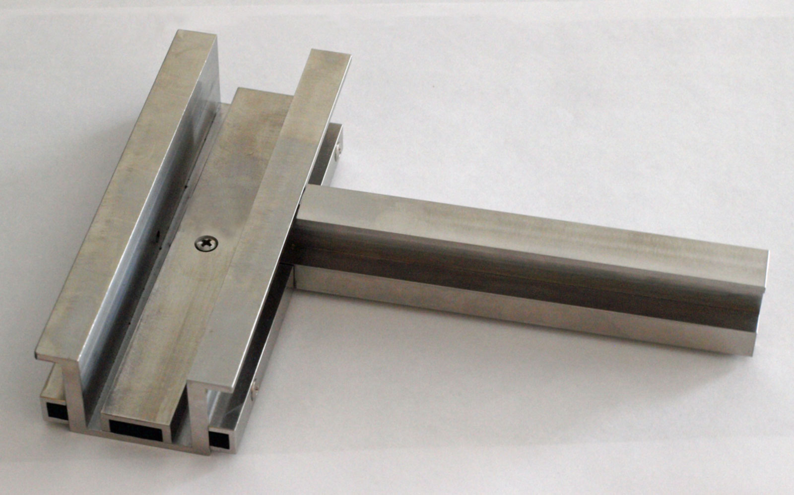 Machined Sample of the Custom Joinery used for the Stainless Steel Curtain Wall application.